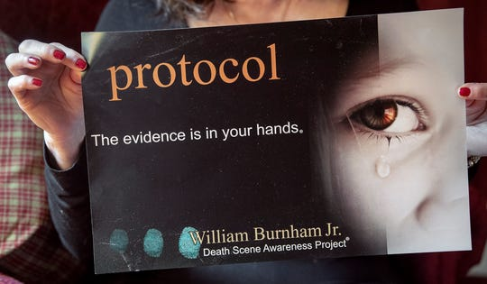 """Nancy Kreiner holds up a poster for the William Burnham Jr. Death Scene Awareness Project. """"Every law enforcement officer, and every coroner, wants to do a really good job. Their heart is into doing a really good job. And they do,"""" Kreiner said. """"But it's always good to be reminded."""""""