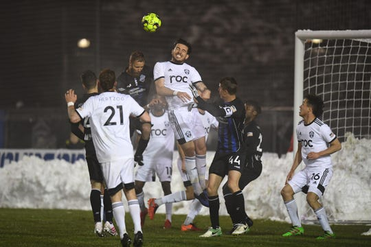 Reno 1868 FC defender Emrah Klimenta (2) clears the ball in front of Colorado Springs Switchbacks FC forward Mike Seth (10) in the first half April 13, 2019 at Weidner Field in Colorado Springs, Colo.