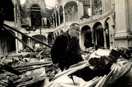 In November 1974, Father Albert Reissner inspects the nave of St. Joseph's Church.