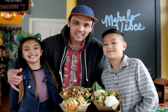 Owner Jaysen Ridout of Pandan Leaf Cafe, a Hawaiian Fusion restaurant and drive-thru, with two of his children, Cece, 8, and James, 9, in Salem on April 15, 2019.