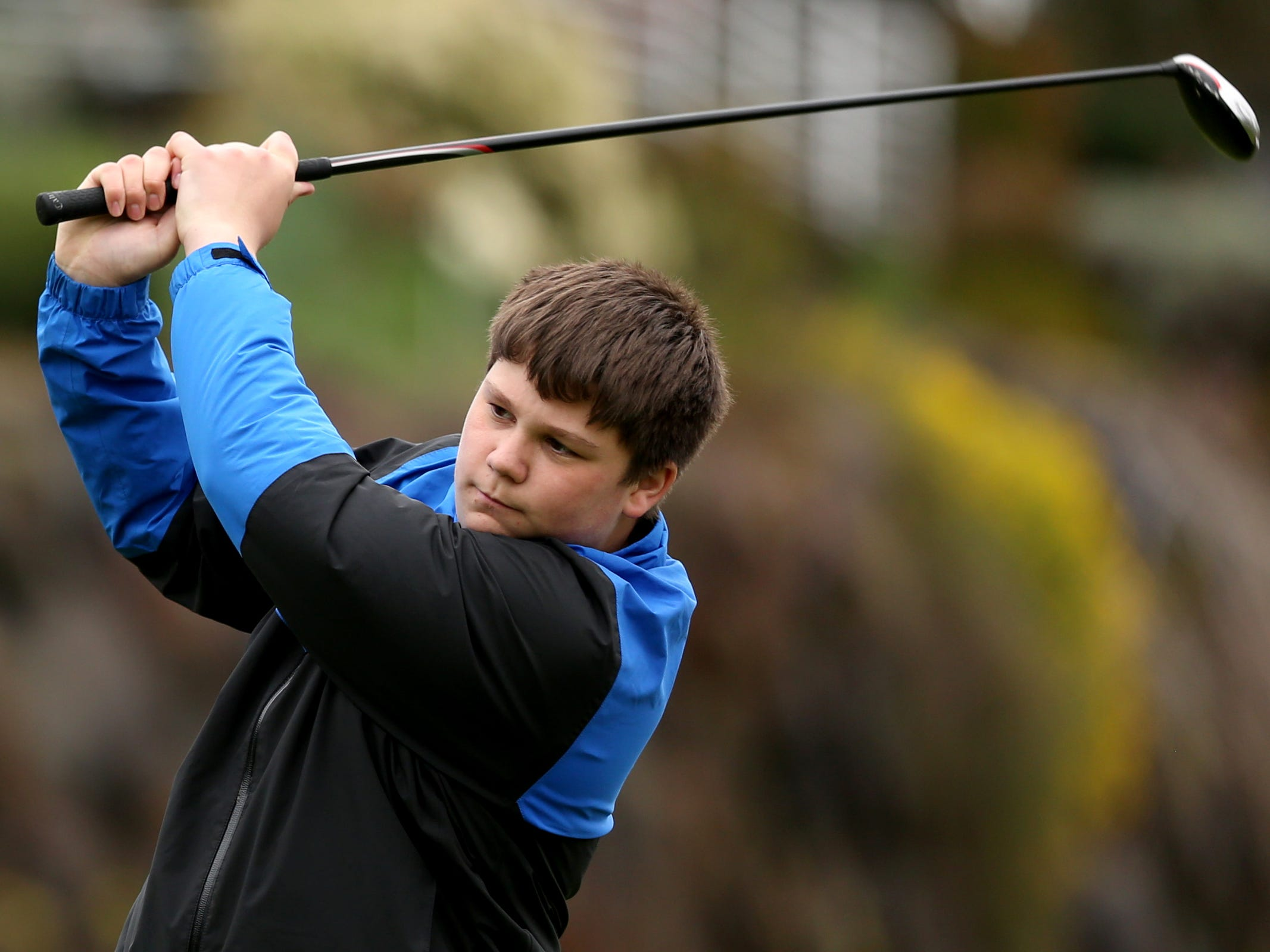 McNary's Brady Jackson tees off during a Mountain Valley Conference league high school golf match at Creekside Golf Club in Salem on April 15, 2019.