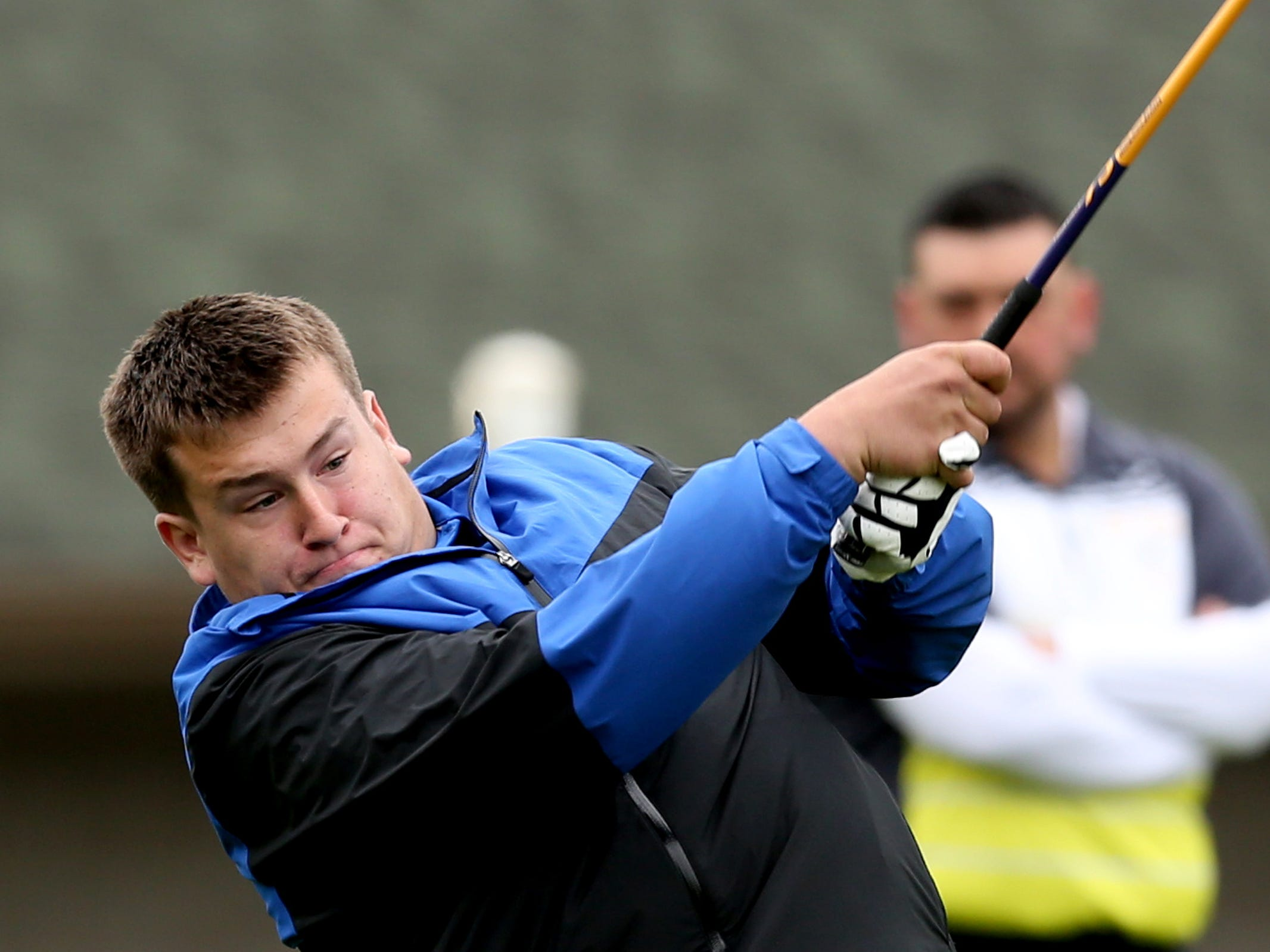 McNary's Nathan Young tees off during a Mountain Valley Conference league high school golf match at Creekside Golf Club in Salem on April 15, 2019.