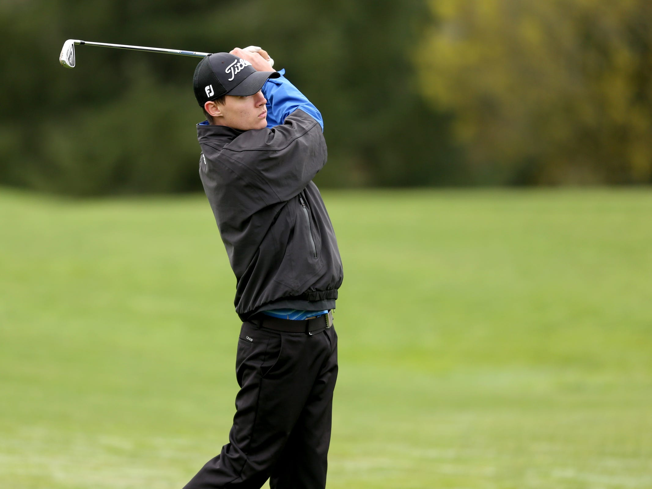 McNary's Joel Dutcher competes during a Mountain Valley Conference league high school golf match at Creekside Golf Club in Salem on April 15, 2019.