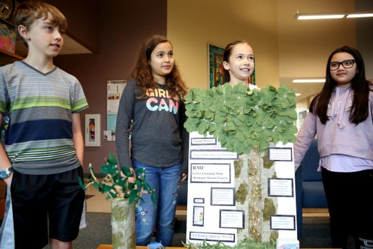 Fourth graders, from left, Micah Robinson, Avalee Turner, Leah Ioane and Gisabelle Espericueta won the regional ExploraVision Science and Technology competition with their project on using shape-shifting leaves to reduce noise pollution. Photographed at Lee Elementary in Salem on April 15, 2019.
