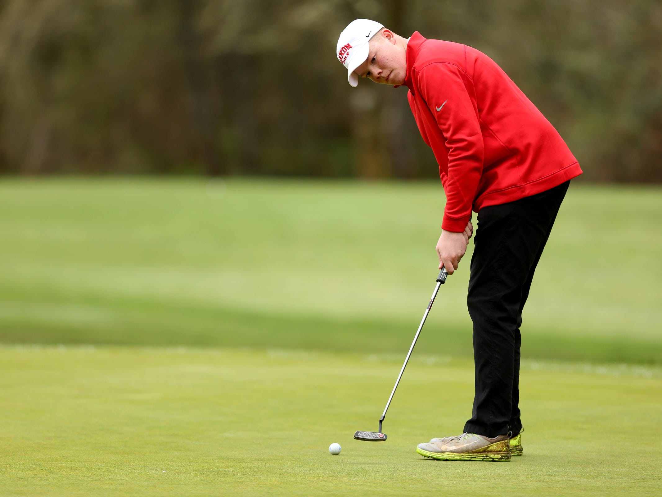 South Salem's Lucas Paul putts during a Mountain Valley Conference league high school golf match at Creekside Golf Club in Salem on April 15, 2019.