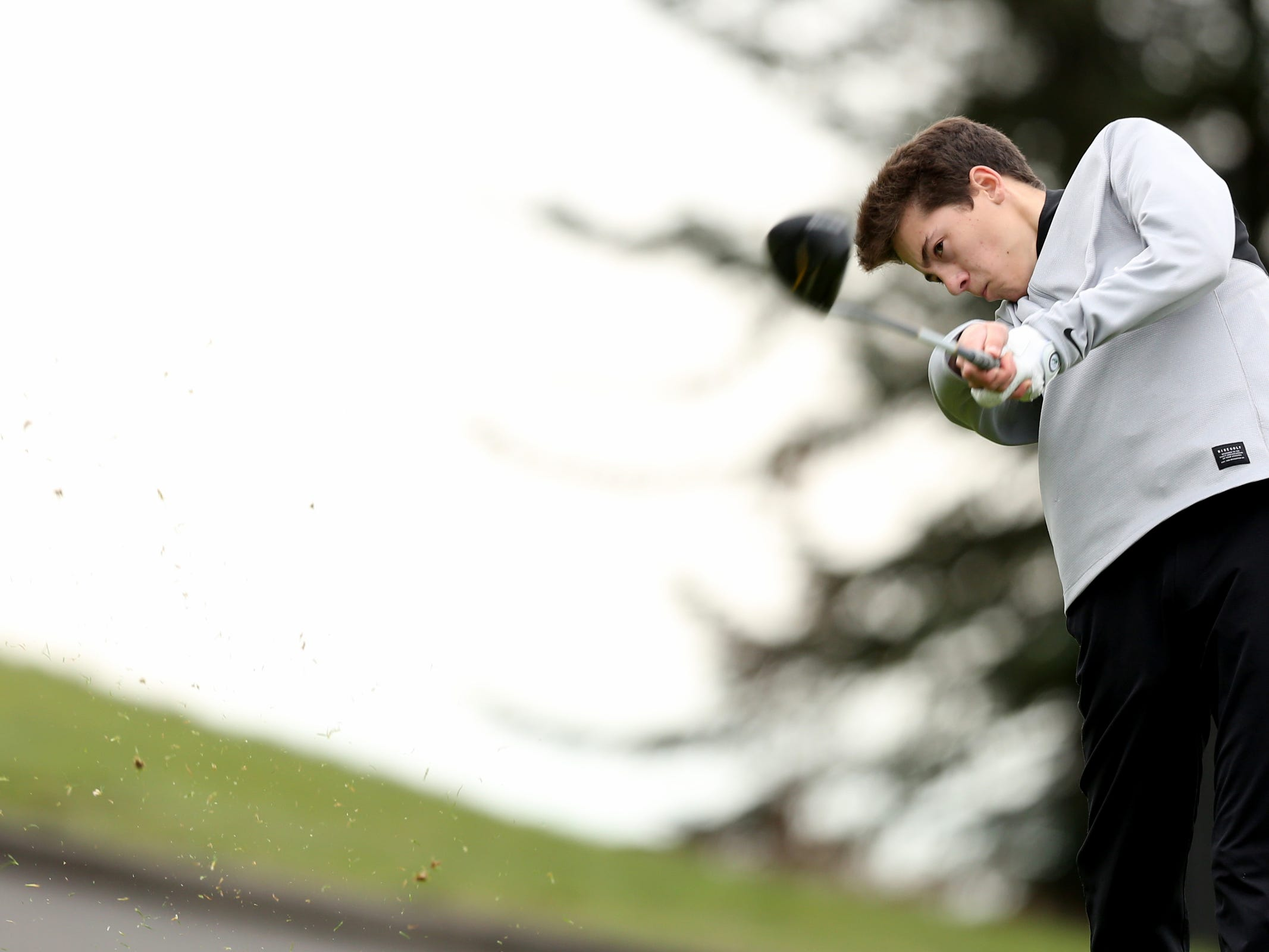 West Salem's Lance McClung tees off during a Mountain Valley Conference league high school golf match at Creekside Golf Club in Salem on April 15, 2019.