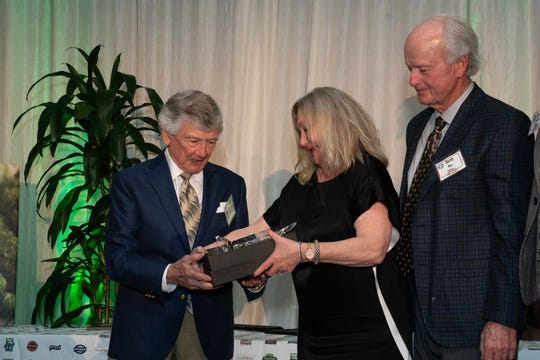 Bill Ramsey receiving award from prior honorees Susan and David Gill.
