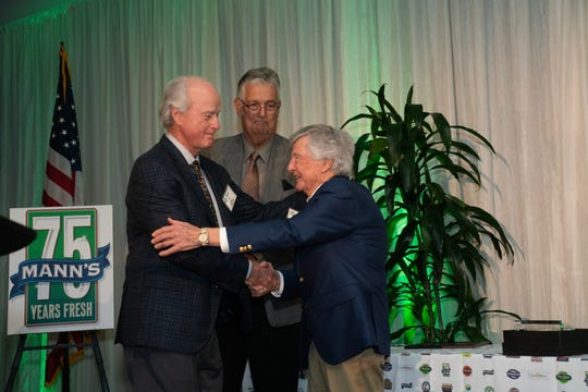 David Gill, Nate Holaday and Bill Ramsey accepting award.