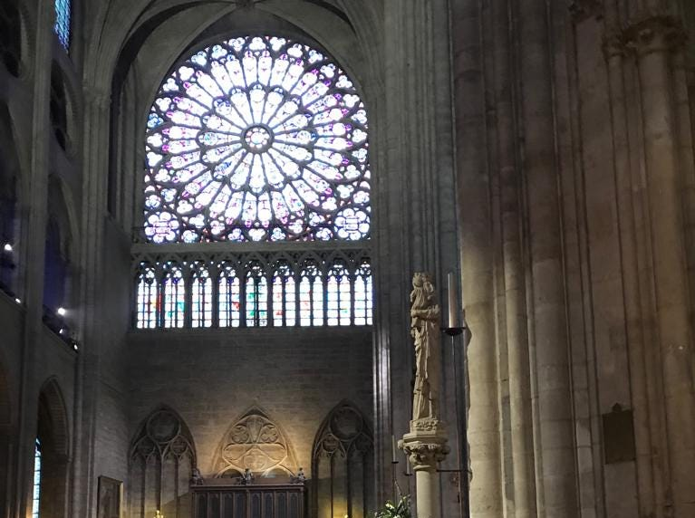 One of the rooms in the Notre Dame cathedral are lit up by stain glass windows.