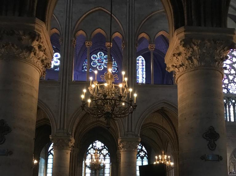 Pillars and chandeliers inside the Notre Dame cathedral.