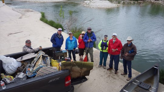 Members of the Llano River Watershed Alliance take a break from the Great Guac Grab on the South Llano River Saturday, April 13, 2019. Pictured from left: Carleton Turner, Andrew Burnard, Melissa Burnard, Eva Broad, Tyson Broad, Martha Richardson, Scott Richardson, Art Mudge.