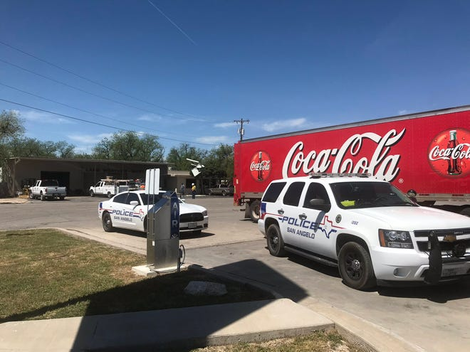 First responders and AEP officials rush to the scene of a downed power line in North San Angelo, Monday April 15, 2019.