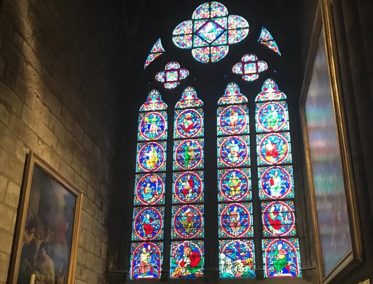 One of the stain glass windows inside Notre Dame cathedral.