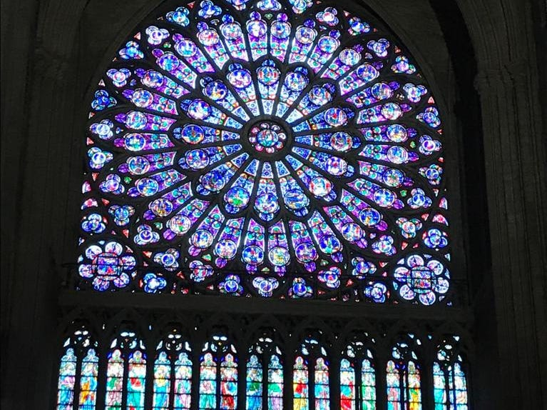 One of the many stain glass windows inside the Notre Dame cathedral.
