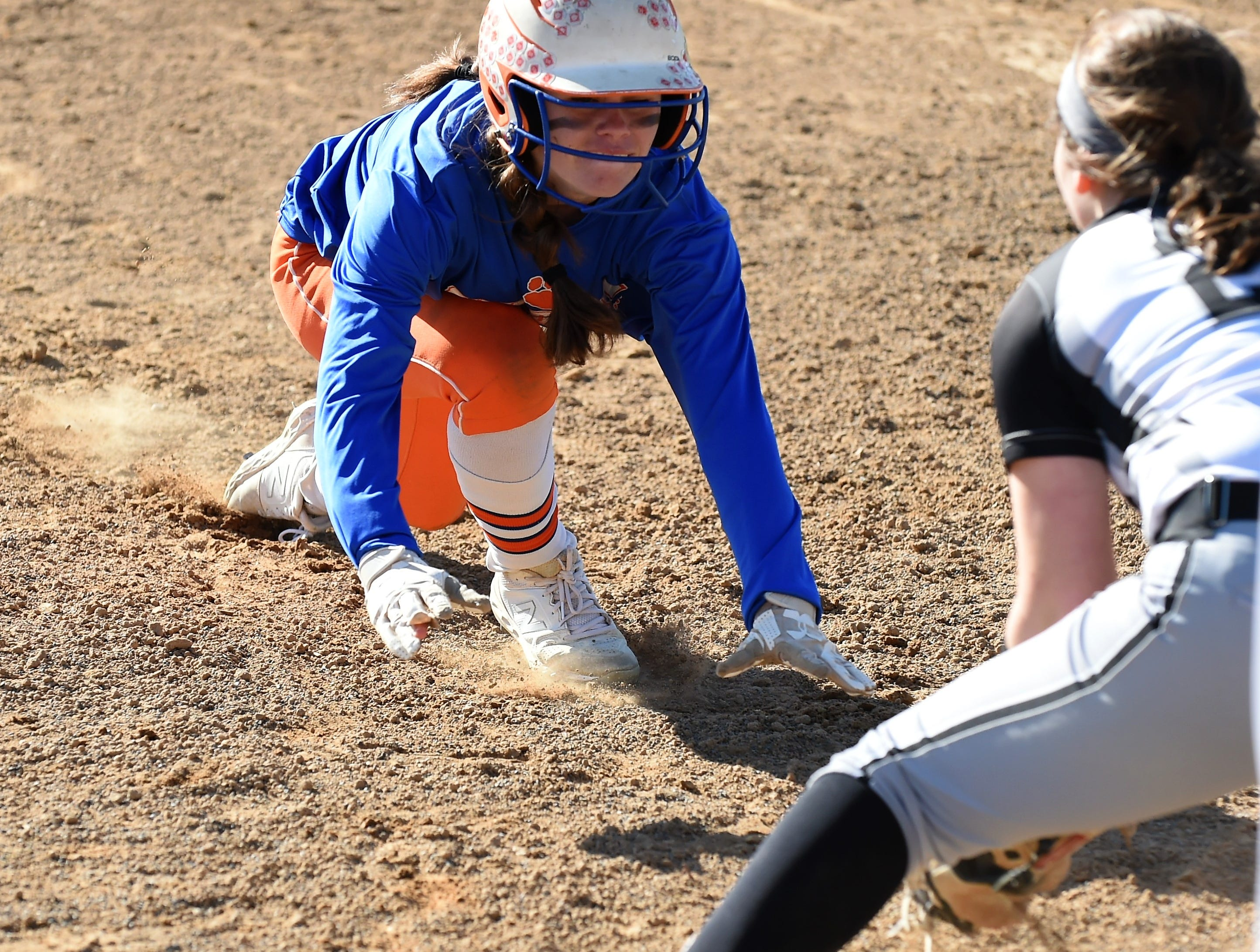 Delmar outfielder Paige Lynch gets caught stealing and tries to slide into first base on Monday, April 15, 2019. The Wildcats defeated Padua Academy, 6-2.