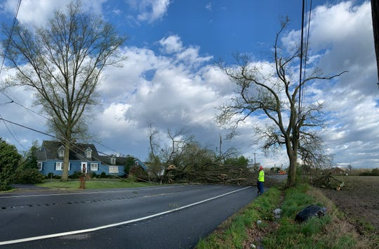Workers clear a fallen tree on Seaford Road near Laurel on Monday, April 15, 2019. A major storm ripped though parts is Sussex County early Monday closing roads and causing damage near Laurel.