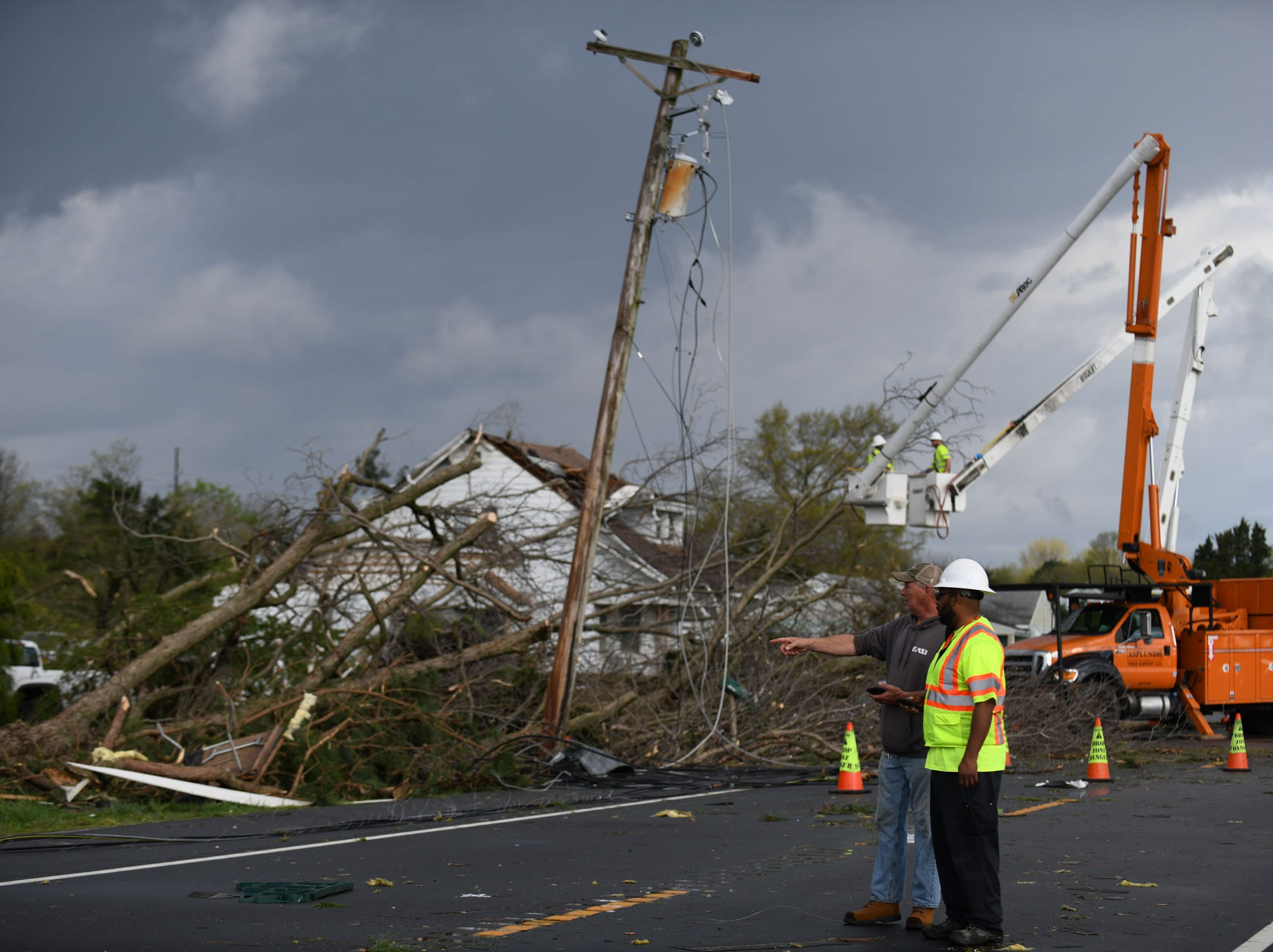 Crews clear downed trees from power lines on Seaford Rd. in Laurel, Del. after a strong band of storms passed through Sussex County on Monday, 15, 2019.