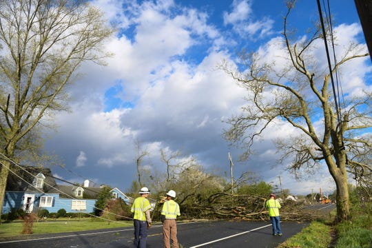 Multiple crews assess the damage on Seaford Rd. after a possible tornado passed through overnight in Laurel, Del. on Monday, 15, 2019.