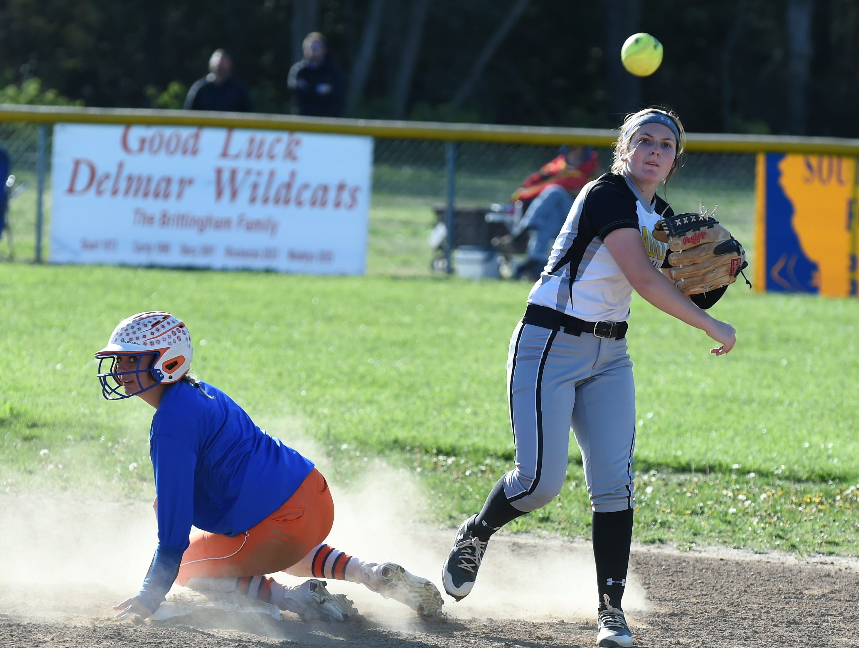 Padua's Caitlin Donnelly throws to first as a Delmar runner slides into second on Monday, April 15, 2019. The Wildcats defeated Padua Academy, 6-2.