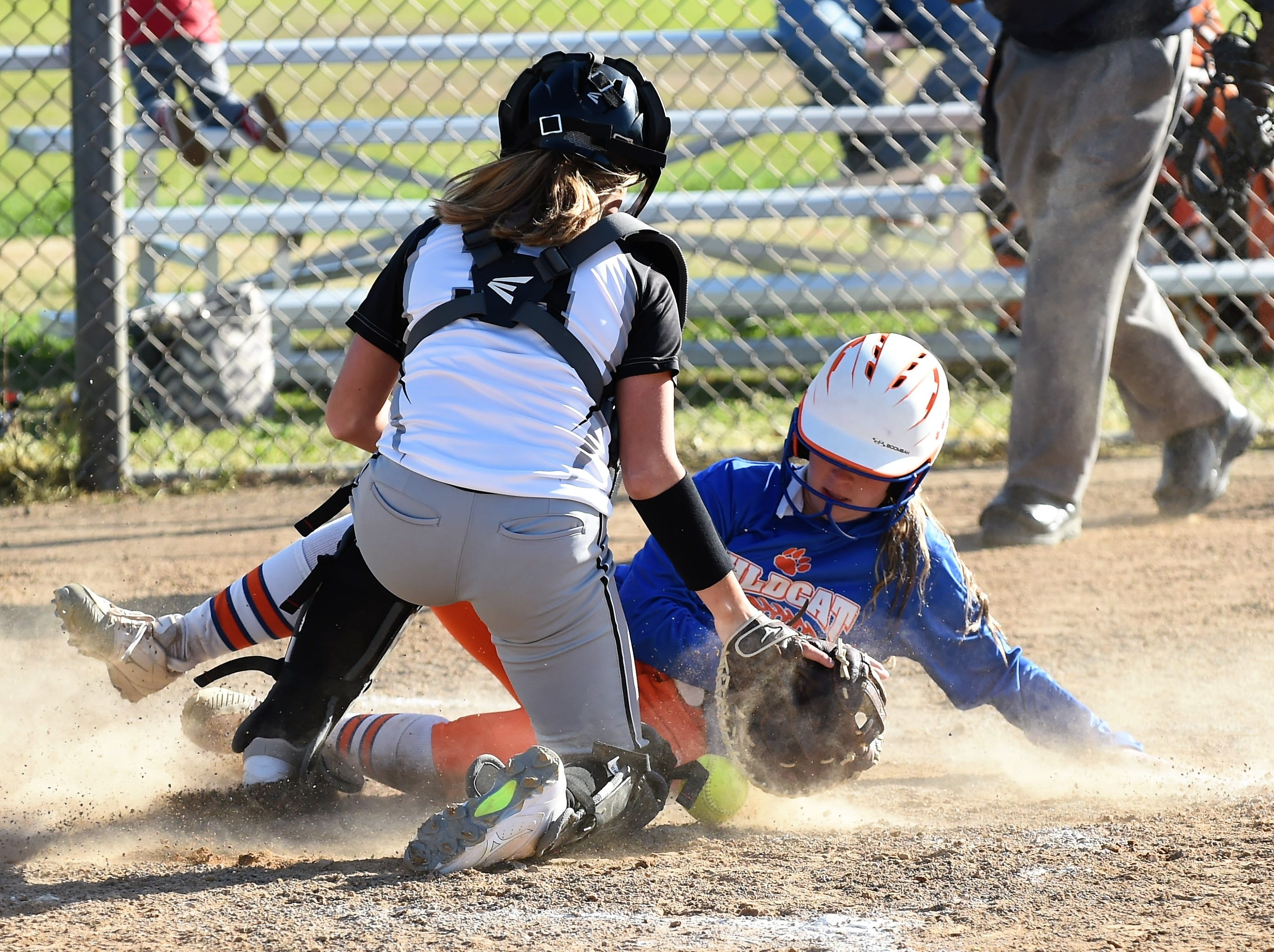 A Delmar player slides into home on Monday, April 15, 2019. The Wildcats defeated Padua Academy, 6-2.