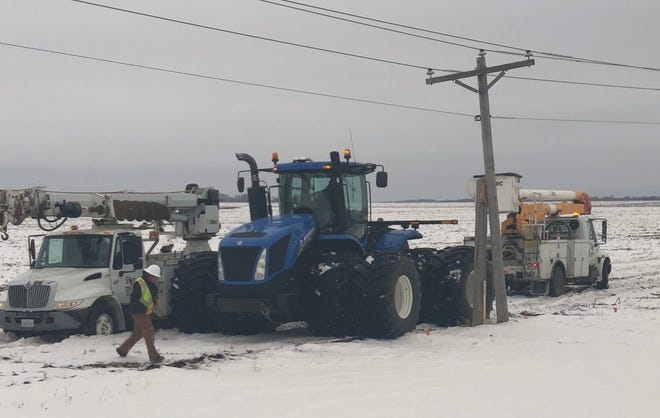 Electric company workers are working steadily to restore power to hundreds of customers  in southeastern South Dakota and southwestern Minnesota after last week's storm, including this crew in a photo submitted Saturday, April 13 by Xcel Energy.