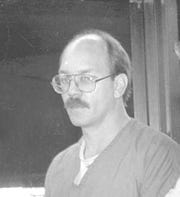 FILE - In this photo from the 1990s, South Dakota death row inmate Charles Russell Rhines in Rapid City, S.D. The Supreme Court is again rejecting the gay death row inmate's appeal that claims jurors in South Dakota were biased against him because of his sexual orientation. (Rapid City Journal via AP)