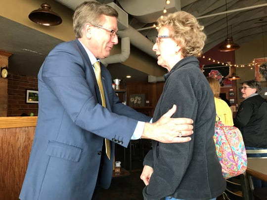 Sioux Falls resident and former mayor Mike Huether chats briefly with a former constituent during a stop at Kaladi's Bistro Monday afternoon.