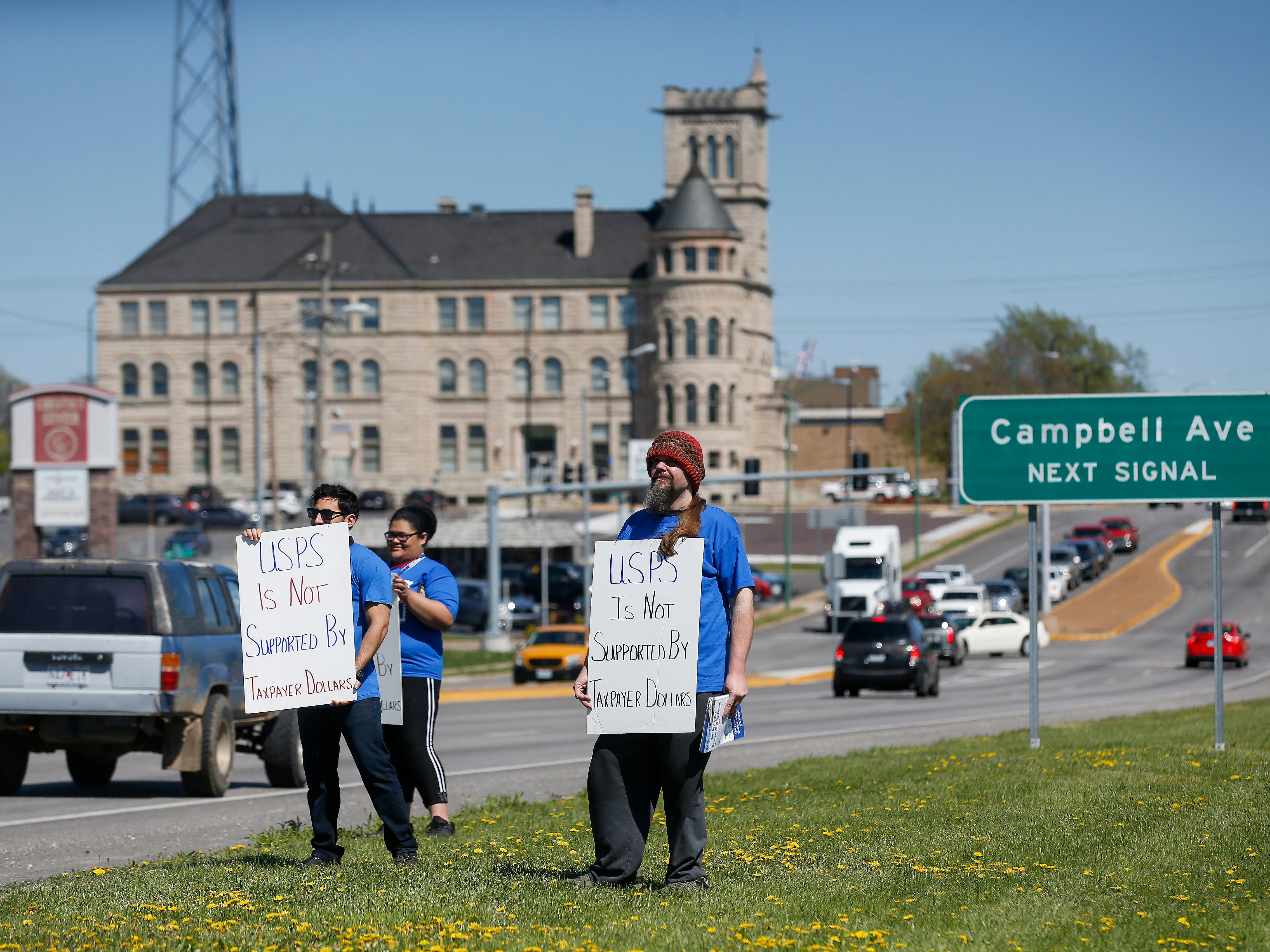 Around 10 U.S. Postal Service employees participated in an informational picket outside of the Post Office at 500 West Chestnut Expressway on Monday, April 15, 2019 to inform the public that they receive no tax dollars.
