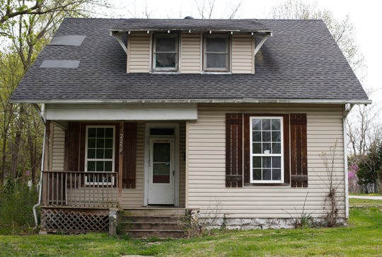 A house formerly owned by Chris Gatley sits on North Main Avenue in Springfield. City inspectors were once called to the home when renters complained about three feet of raw sewage flooding the basement.