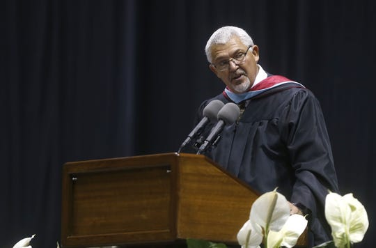 Hillcrest High School principal Garry Moore, speaking at the 2017 graduation at JQH Arena, will step down June 30. His future plans have not yet been announced.
