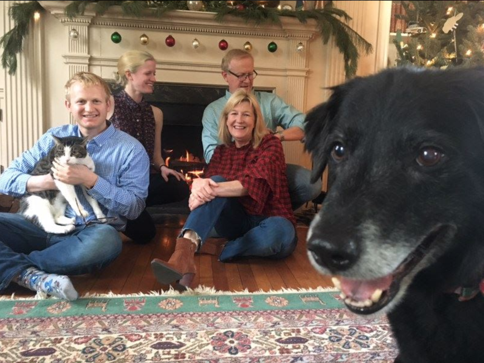 Dr. Robert Kyler with his family and Fritz, the photobombing dog, in their home in Staunton, Virginia, in December 2017. On July 20, 2018, Kyler was in a bike accident that left him paralyzed from the waist down.