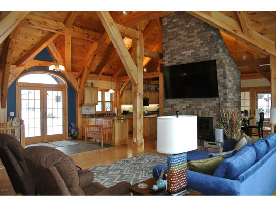 Spread out on all sides of this floor-to-vaulted ceiling structure are the foyer, living room, dining room and kitchen.