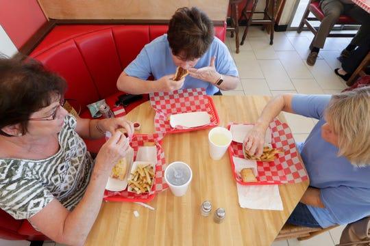 Friends Lynda Dennis, Kim Harrington and Rhonda Taylor enjoy Dog Et Al, a favorite spot of theirs to reunite, for lunch Monday, April 15, 2019.