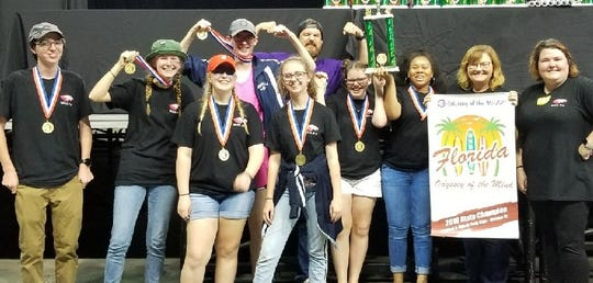 """Winning 2019 WHS Team A consists of senior Jake Greene; juniors Abigail Gray, Ally Harden, Zoie Hill, """"Jay"""" Jacob, and Ashiera Preston; and freshman Abbi Hatfield.  Coaches are WHS Engineering Academy teacher Christopher Stearns and WHS Reading Coach Angie Gentry."""