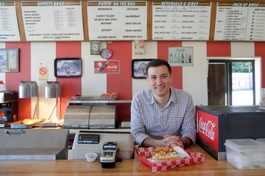 Dog Et Al Owner Operator Alex Douglas stands behind the counter of the 35-year-old hot dog shop he recently took over Monday, April 15, 2019.