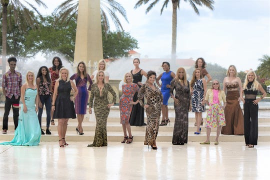 Models and designers, many wearing Mochachino NY LA couture, at the Grand Harbor fountain, from left, first row, Sheri Altic, Christine Hughes, Laura Guttridge, Marianna Greer, Bonnie Mixon, Lewana Dupree, Mary Angel, and Jodi Harvey; second row: Sabre Mochachino, Crystal Appadoo, Dana Hagood, Nadja Ricci, and Lauralie Sammons; third row: Yvette Jones Pryor, Jerrica Knowles, Cammy Ioannides, Nithchel Marcelin-Joyce, and Paula Bushell.