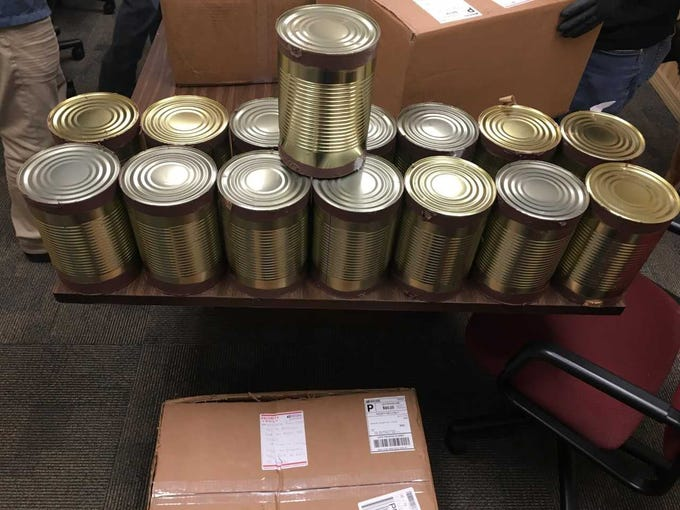 Detectives found four boxes packed with marijuana in vacuum-sealed aluminum cans at the front desk of a Port St. Lucie hotel. Damion Thomas, 34, of Lauderdale Lakes was arrested.