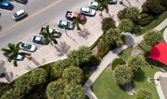 Street parking is seen in a drone aerial photo Friday, April 12, 2019, along Ocean Drive near Humiston Park in Vero Beach.