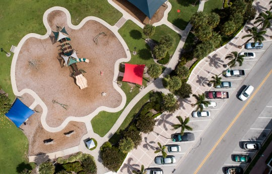 Street parking is seen at right in a drone aerial photo Friday, April 12, 2019, along Ocean Drive near the playground at Humiston Park in Vero Beach.