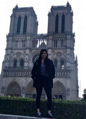 Tulare resident Desiree Sorsby poses for a photo in front of Notre Dame Cathedral hours before the famous structure caught fire.