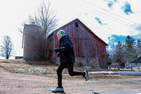 "Allan ""Fish"" Stieber, of Owen, runs during his training Wednesday, April 3, 2019, on County Road U in Rib Falls, Wis. T'xer Zhon Kha/USA TODAY NETWORK-Wisconsin"