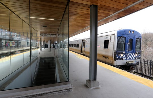 A train pulls into the White Plains Metro-North train station, which has a new look with glass walls, wooden ceilings, exposed beams April 11, 2019.