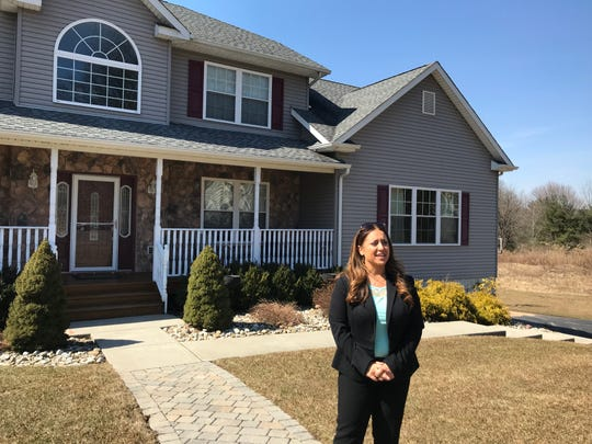 Shari Porter, real estate agent with Better Homes and Gardens Rand Realty, talks about the spring housing market in front of her listing at 10 Polo Court in Ramapo.