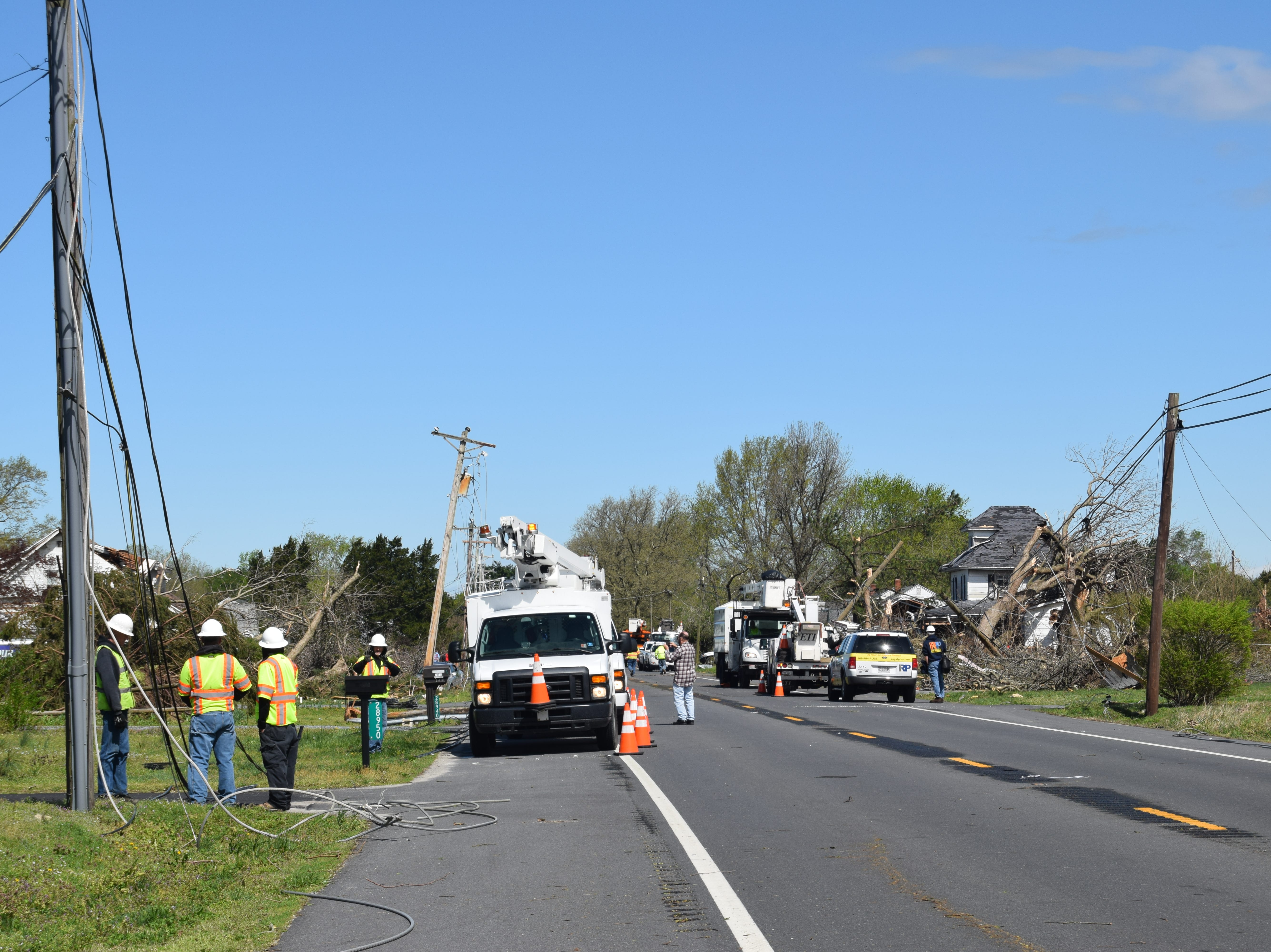 Some of the heaviest storm damage could be found on Seaford Road in Laurel, where crews from multiple agencies and companies worked to clear debris, limbs and downed power lines on Monday.