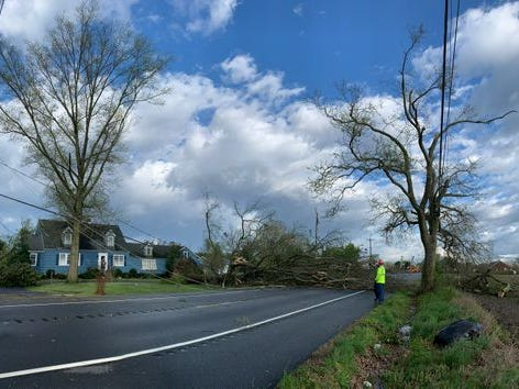 Workers clear a fallen tree on Seaford Road near Laurel on Monday, April 15, 2019. A major storm ripped though parts of Sussex County early Monday, closing roads and causing damage near Laurel.