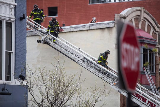 Wilmington Fire Department works the scene of a restaurant fire Monday afternoon on Market Street. Nobody was injured in the fire.