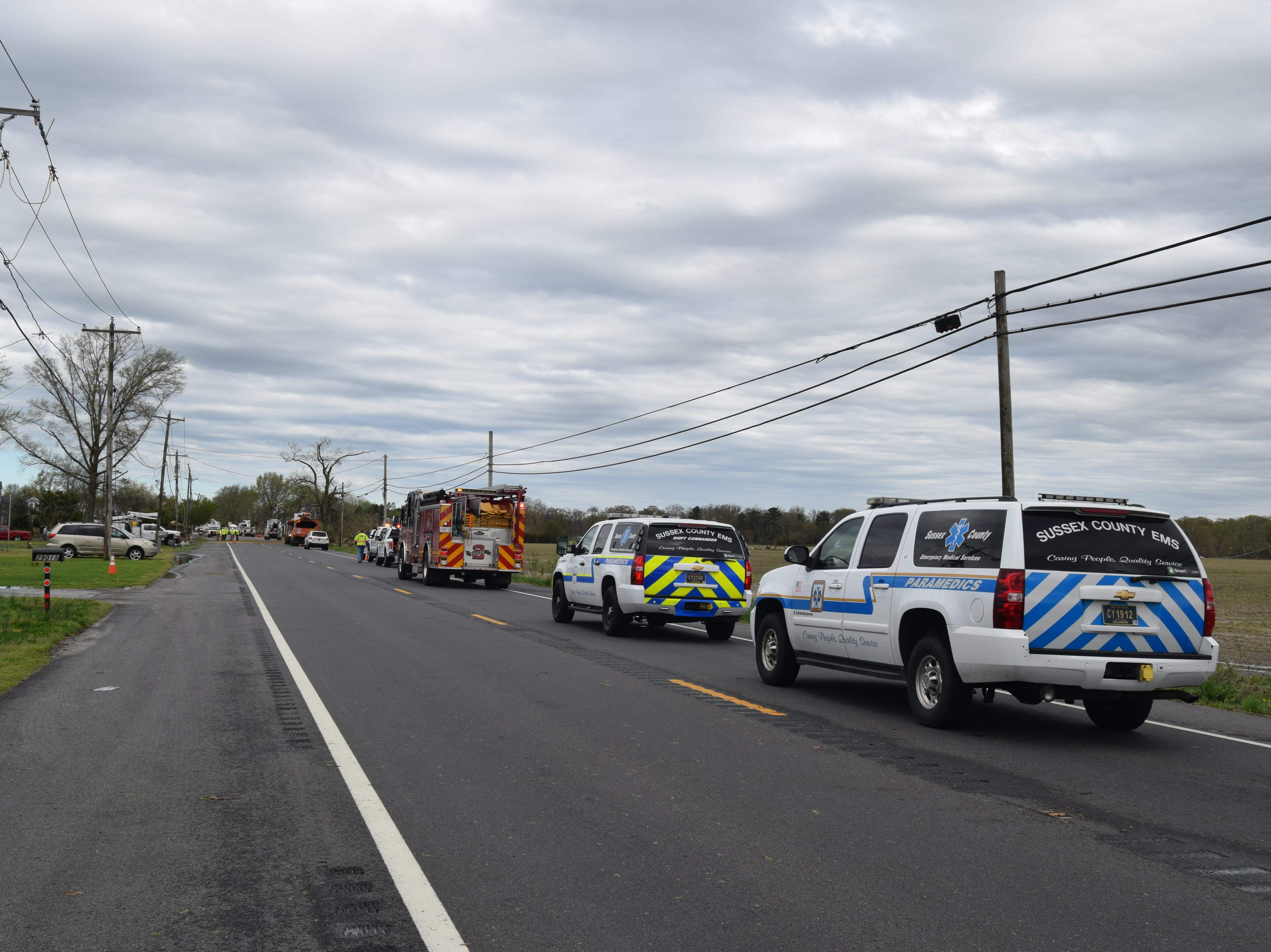 Some roads in the Laurel area remained closed hours after a storm swept through the area overnight. Here, Seaford Road is blocked by emergency crews who said that area was among the hardest hit.