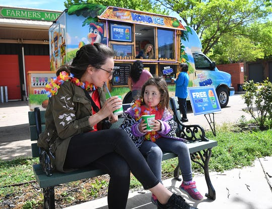"Asya Yarali and her daughter, Handan Yarali, 4, enjoy a free Kona Ice at the Farmers Market Monday morning as part of Kona's ""National Chill-Out Day"" which coincides with Tax Day each year."