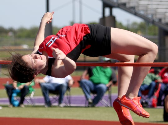 Holliday's Gracie Story competes in the high jump Monday, April 15, 2019, in the Area 7/8-3A Track and Field Championship in Jacksboro.