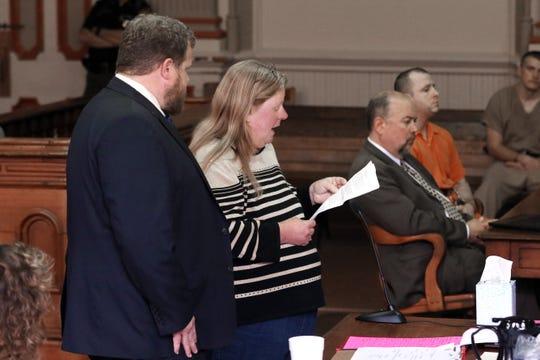 Michelle Stevens addresses the court during the sentencing hearing for Danny Devoll, Jr. Devoll killed Stevens' son Eric in 2018. Devoll is at far right.